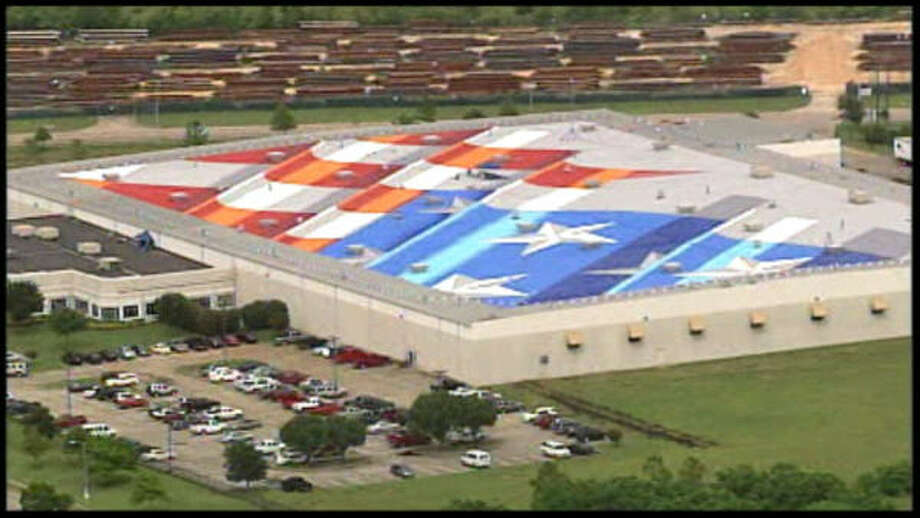 Artist Scott LoBaido's depiction of a giant flag takes shape on the roof of the Lamons Gasket Co., near Hobby Airport. He began painting June 14 and set July 4th as his deadline. Photo: KHOU.COM