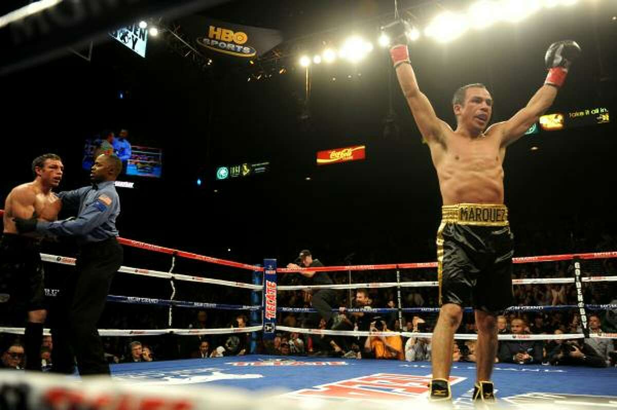 Juan Manuel Marquez of Mexico celebrates after the referee steps in to rescue Australian Michael Katsidis in the ninth round during their WBA & WBO lightweight title bout at the MGM Grand Garden Arena in Las Vegas.