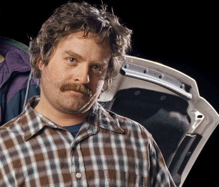 Zach Galifianakis, without a beard (but still rockin' a sweet 'stache) Photo:  IAN WHITE, ASSOCIATED PRESS