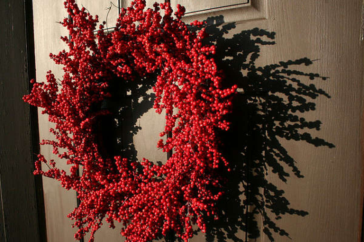 BUY: An all-red wreath pops with the color of the season and works both on your front door and inside.