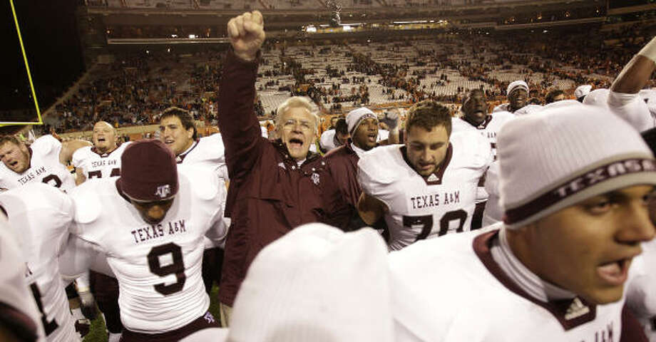 Nov. 25: No. 17 Texas A&M 24, Texas 17Coach Mike Sherman and the Texas A&M Aggies stood tall after beating rival Texas on Thanksgiving Day in Austin. The Aggies finished the regular season 9-3. The Longhorns, on the other hand, finished 5-7 for their first losing season since 1997. Photo: Karen Warren, Chronicle