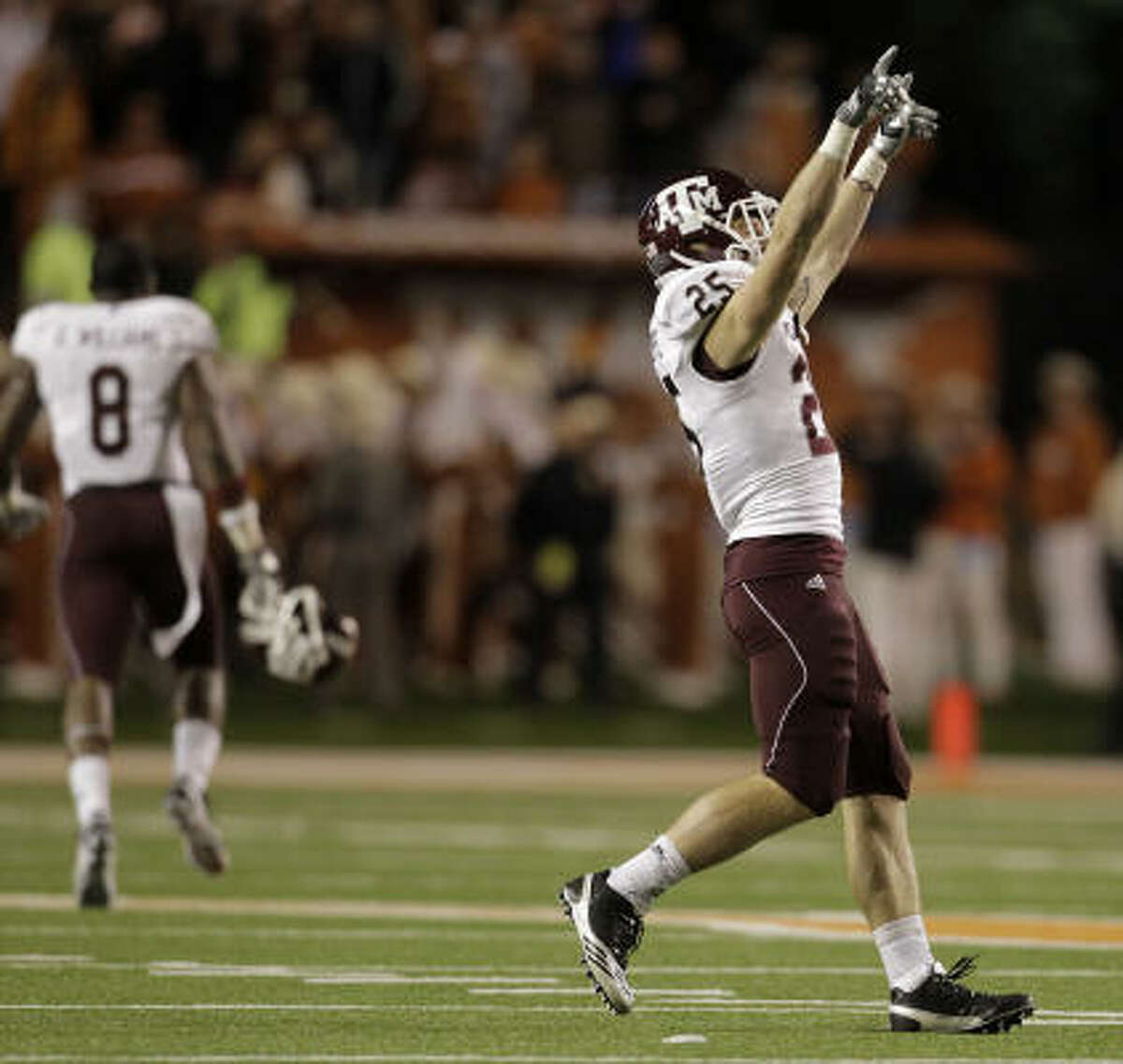 Aggies wide receiver Ryan Swope celebrates on the field after Thursday's win.