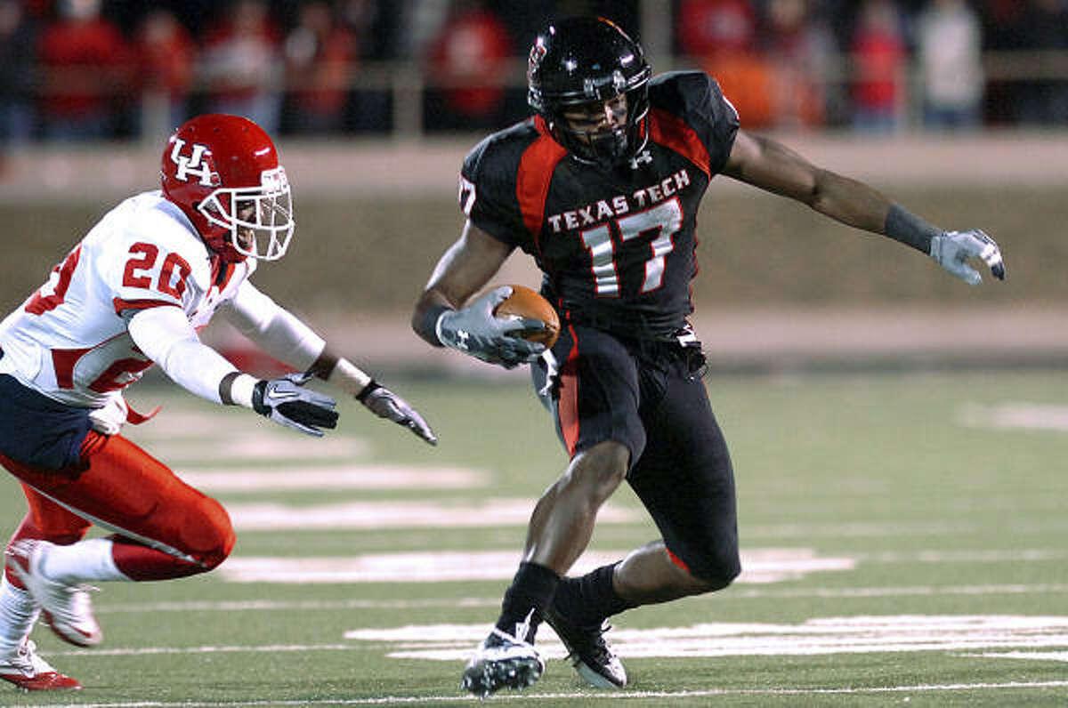 Texas Tech's Detron Lewis (17) gets past UH's Devin Mays.