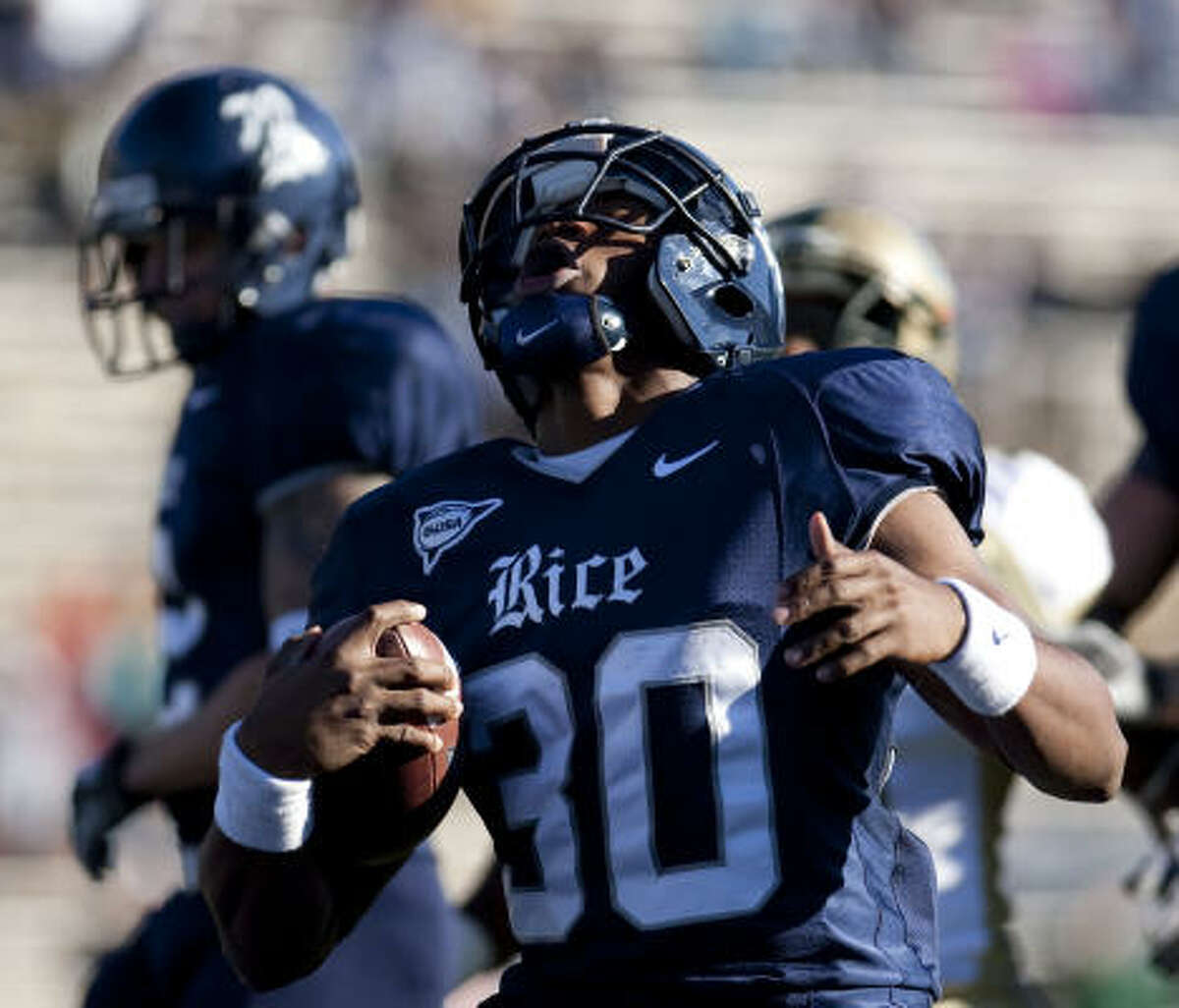 Rice running back Jeremy Eddington rejoyces as he easily scores a touchdown from the Wildcat formation in the second quarter.