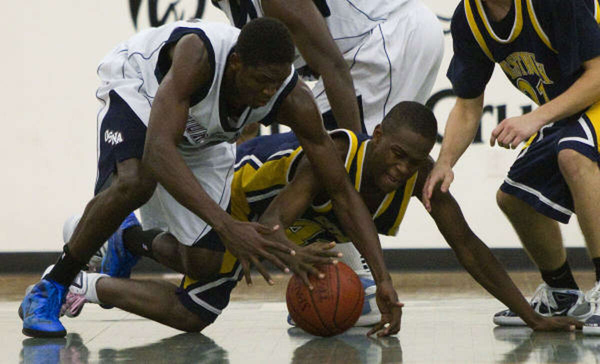 Christopher Obekpaq, left, of Our Savior New American (N.Y.) dives to the floor with Westbury Christian's Saro Ntagha.