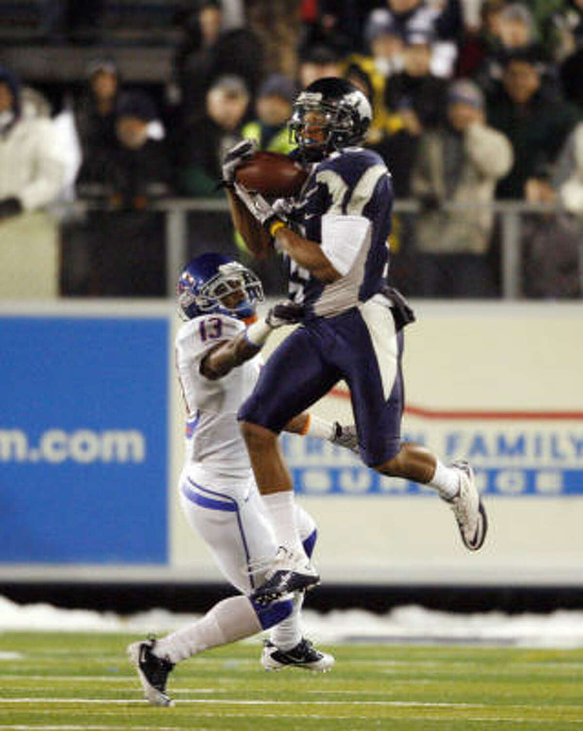 Nevada wide receiver Rishard Matthews catches a pass over Boise State cornerback Brandyn Thompson.