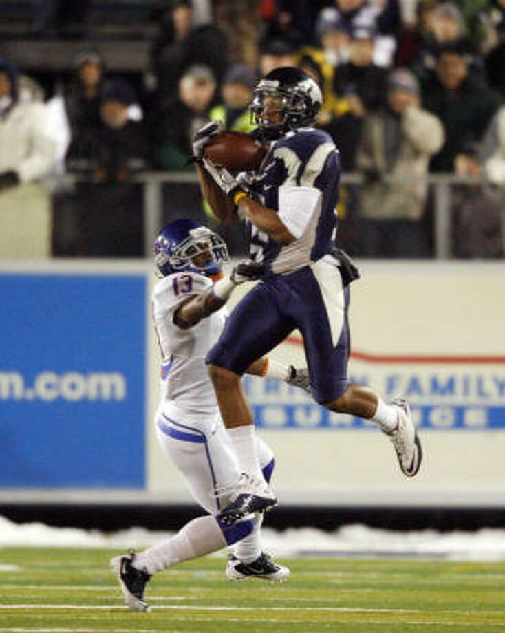 Nevada wide receiver Rishard Matthews catches a pass over Boise State cornerback Brandyn Thompson. Photo: Joe Jaszewski, AP