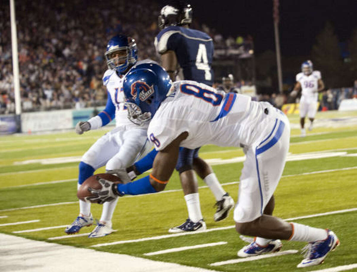 Boise State safety George Iloka grabs an interception in front of the sideline during the first quarter.