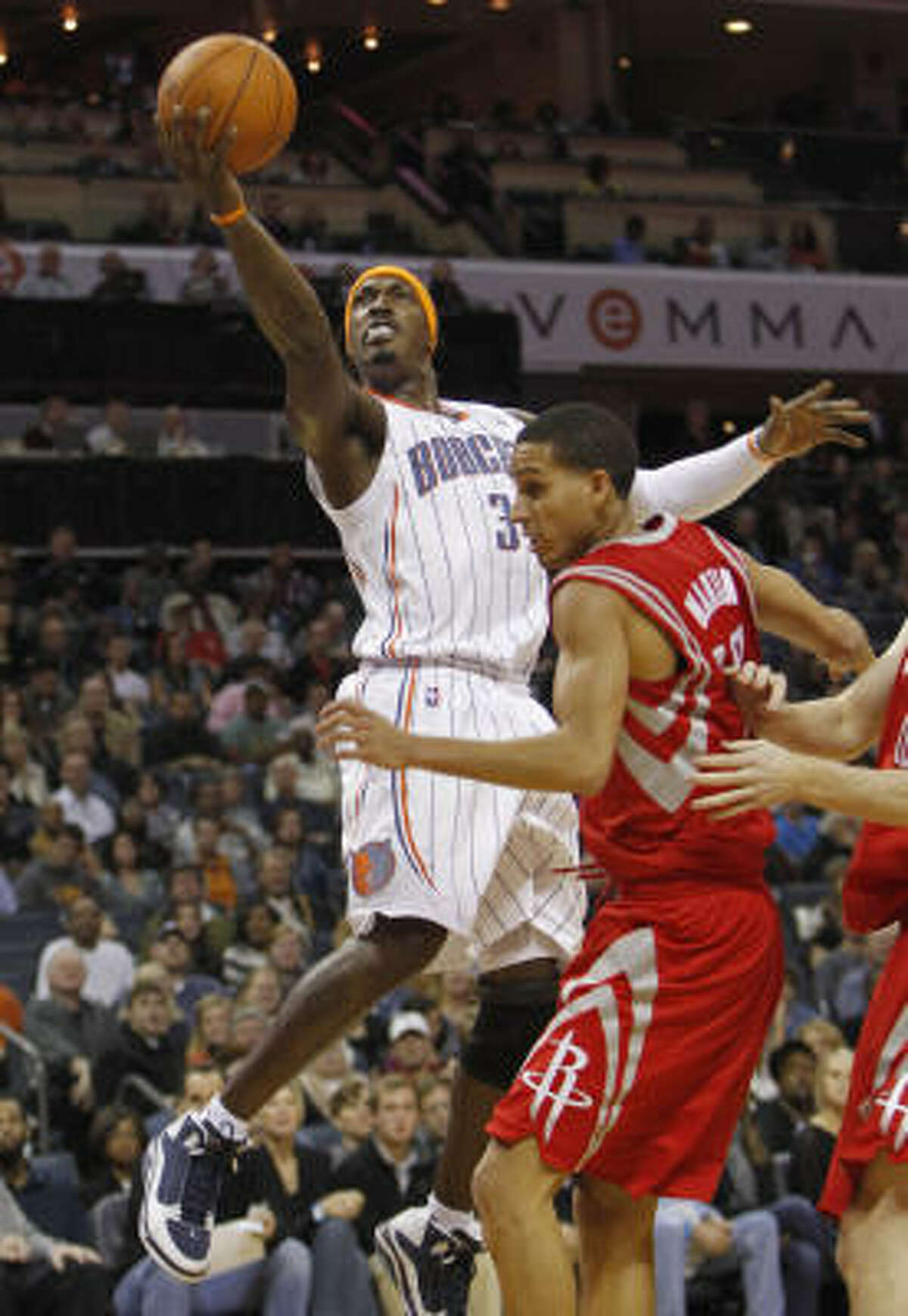 Bobcats forward Gerald Wallace (3) drives against Rockets guard Kevin Martin (12).