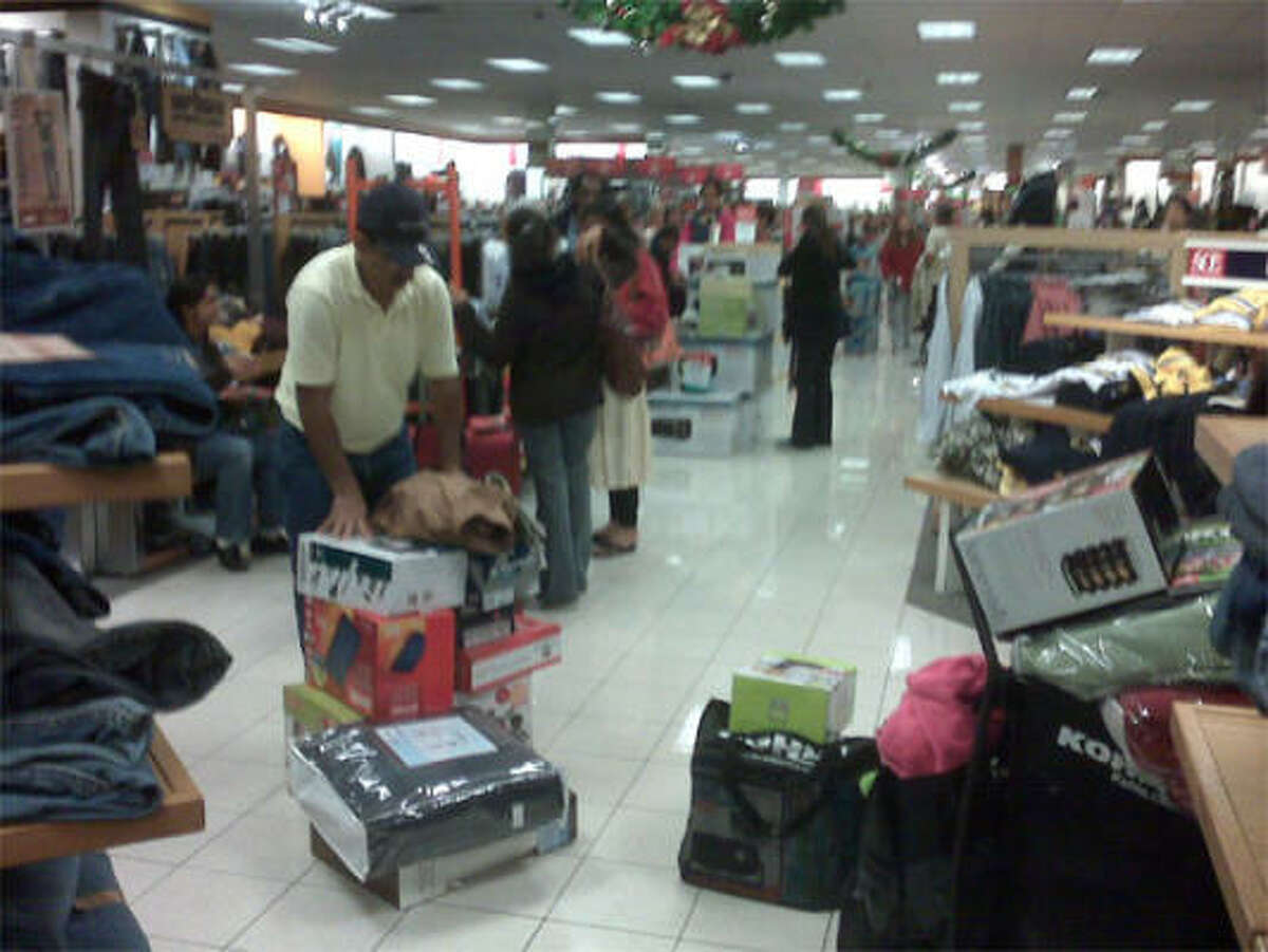 Early-rising Black Friday shoppers invade a Houston Kohl's store on Highway 6. The store opened at 3 a.m.