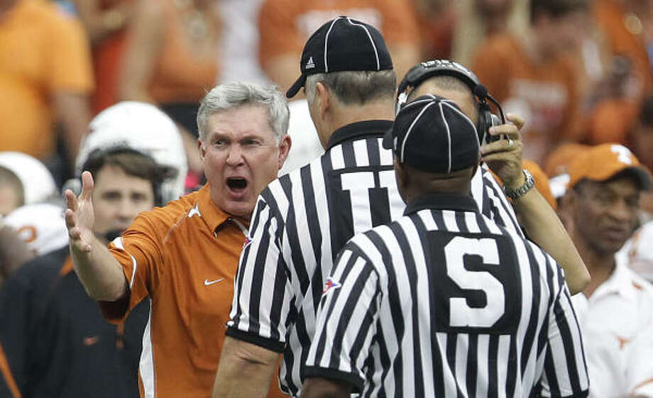 Texas coach Mack Brown will encounter a team coping with tragedy when UT faces Wyoming. Photo: Nick De La Torre, Chronicle