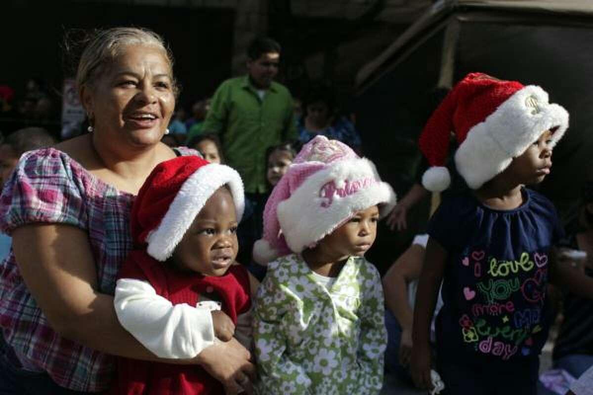 Spectator Annette Arceneaux spends some quality time with grandchildren Kaylin Barcus, 1, Annette Joseph, 1, and Mackenzie Joseph, 3