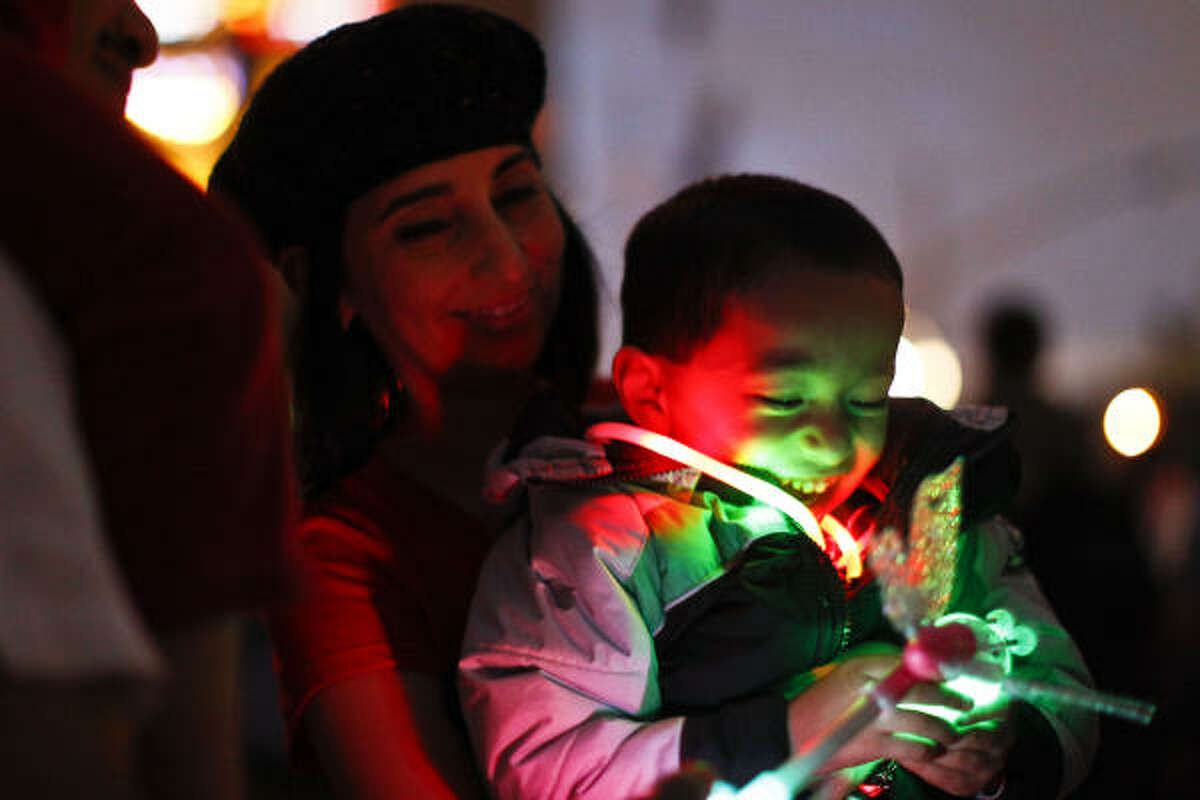 Priscilla Garcia and her son Angel, 4, were among the more than 100,000 at the Uptown Holiday Lighting, which is in its 25th year.