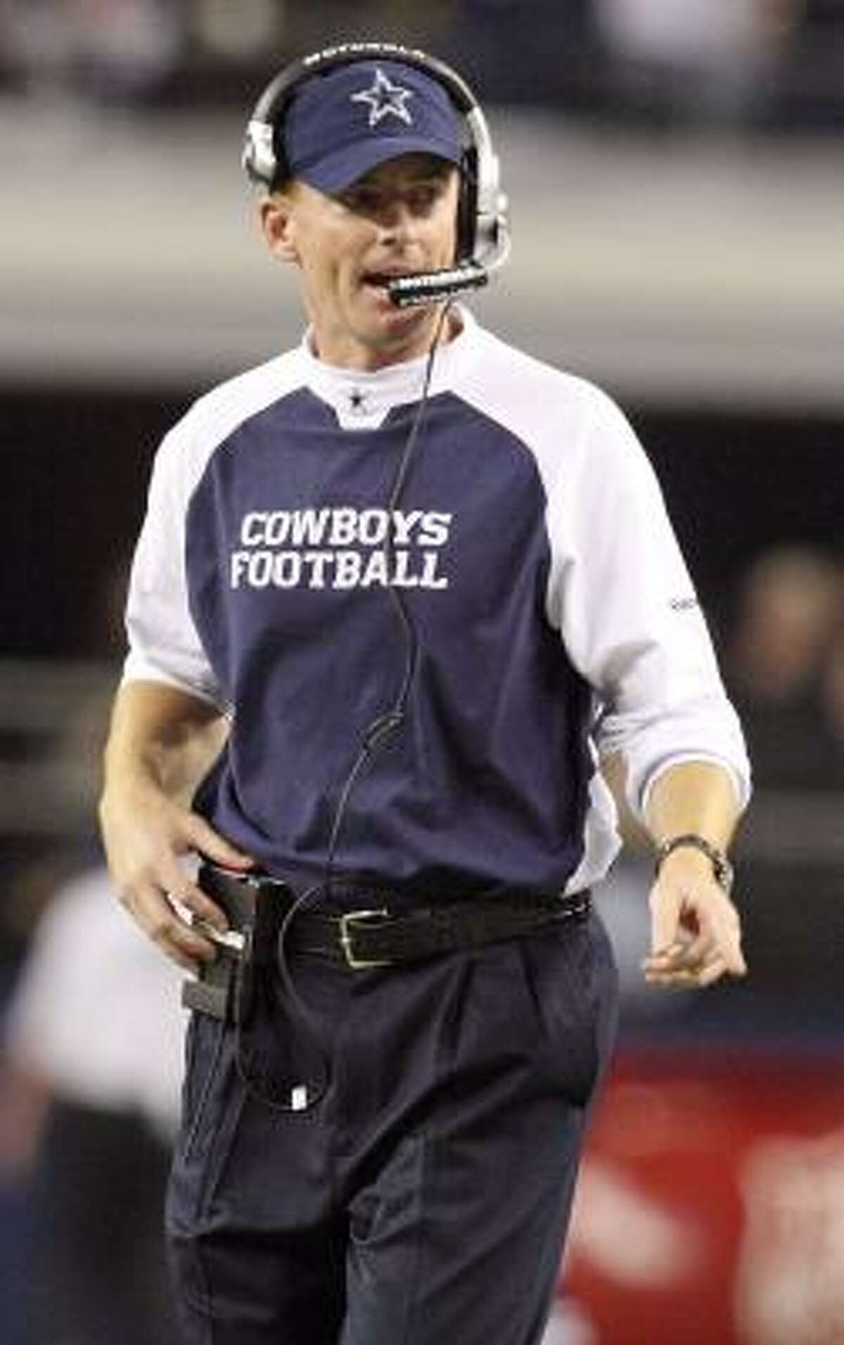 Cowboys interim coach Jason Garrett gives instructions through his headset.