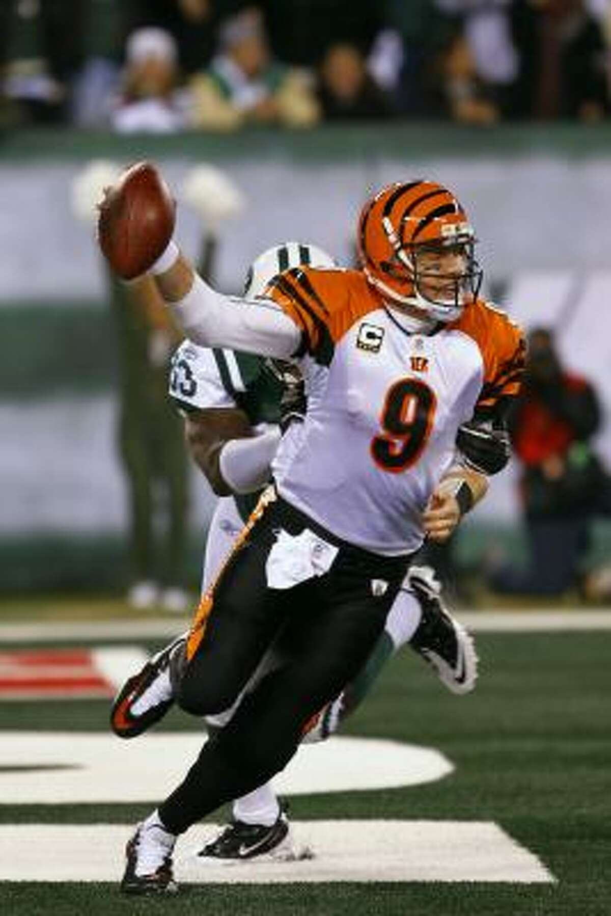 Bengals quarterback Carson Palmer (9) is tackled in the end zone for a safety by New York's Trevor Pryce.