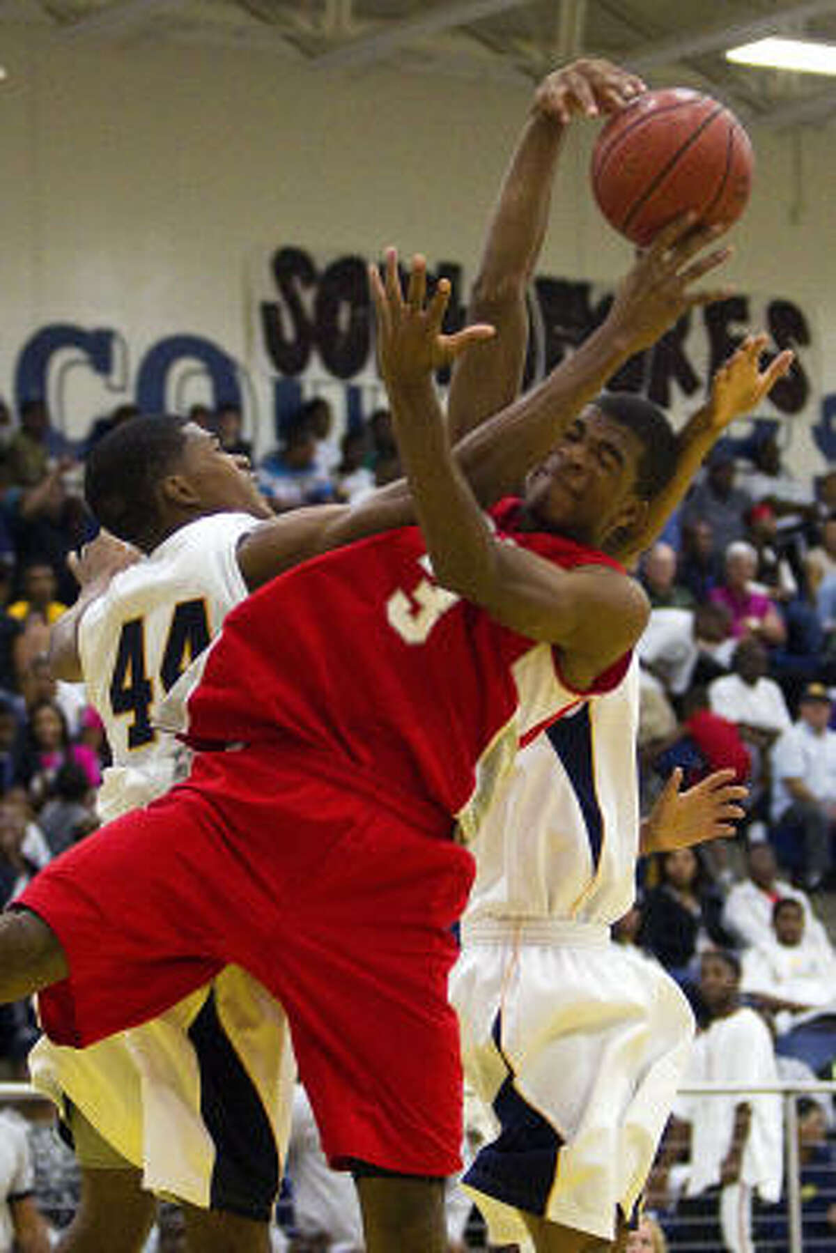 La Marque's DeQuentin Greer (44) and Travis' Aaron Harrison (3) battle it out.