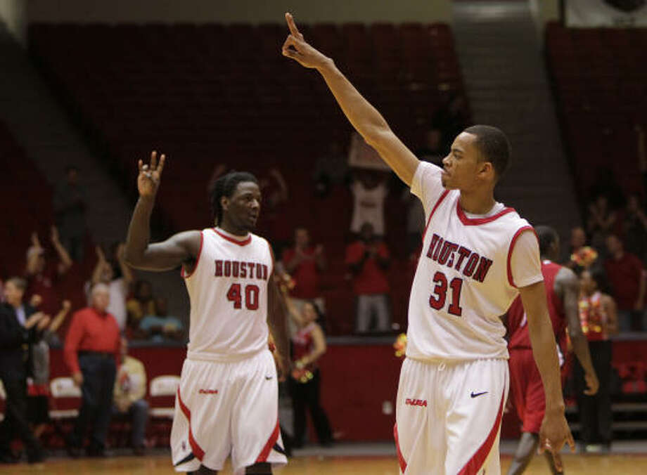 UH's Kendrick Washington, left, and Adam Brown celebrate the victory. Photo: Mayra Beltran, Houston Chronicle