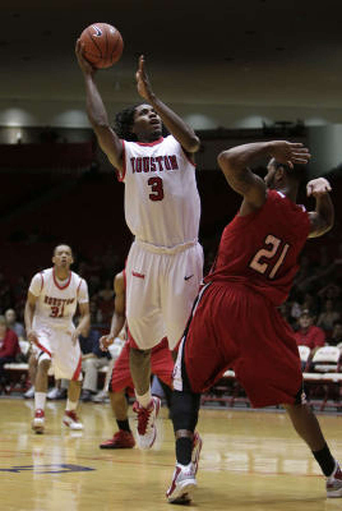 UH's Maurice McNeil puts up a shot in the first half.