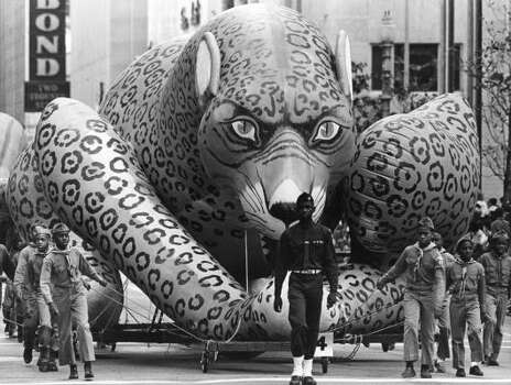 Menacing leopard prowls through downtown during the 1965 Foley's Thanksgiving Day Parade. Photo: David Nance, Chronicle File