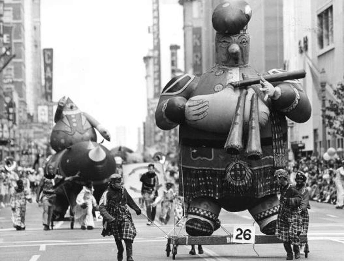 A Scotsman and his bagpipes during the 1965 Foley's Thanksgiving Day Parade.