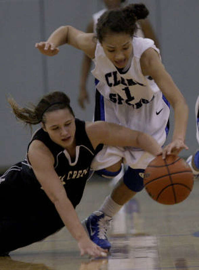 Brooke McCarty (1) of  Clear Springs leads the Chargers' defensive effort. Photo: Thomas B. Shea, For The Chronicle