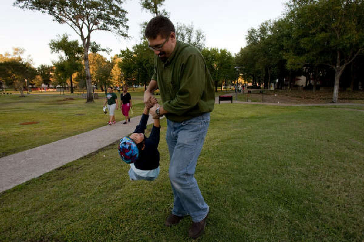 Raul Ramos, a history professor at the University of Houston, plays with his son Joaquin, 4, outside the Cougar Village dorm, where he lives with his family in Houston. Ramos, his wife and two sons are living the U of H dorm this year as part of the university live-in faculty program.