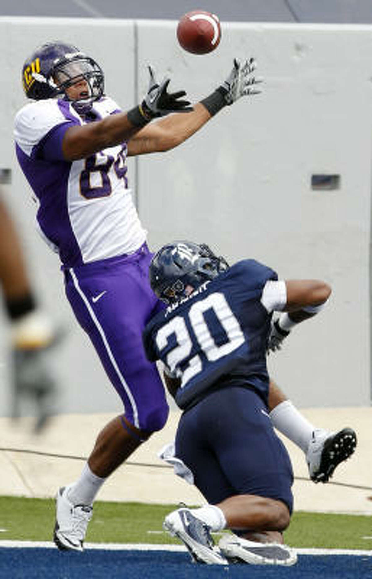Rice defender Corey Frazier (20) breaks up pass in end zone intended for East Carolina's Justin Jones.