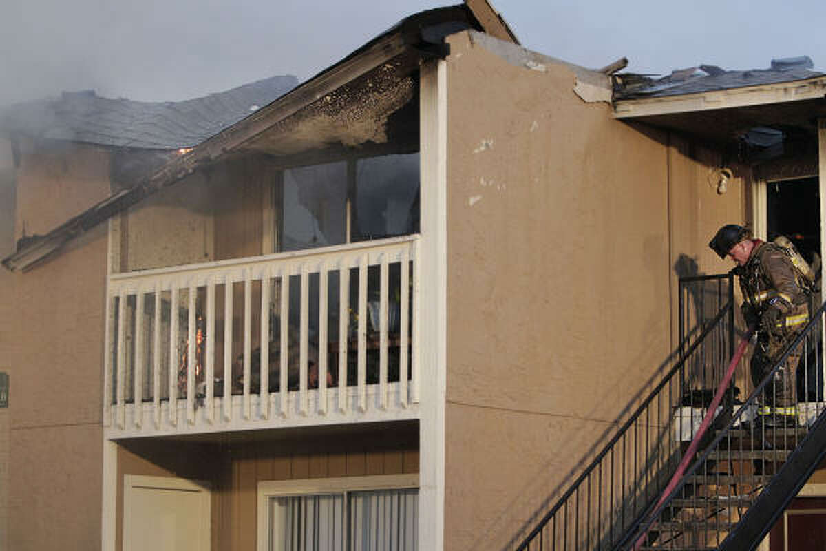 Flames were shooting through the roof shortly after 4 p.m. when Pasadena firefighters pulled into the Cinnamon Ridge apartments in the 6500 block of the Spencer Highway.