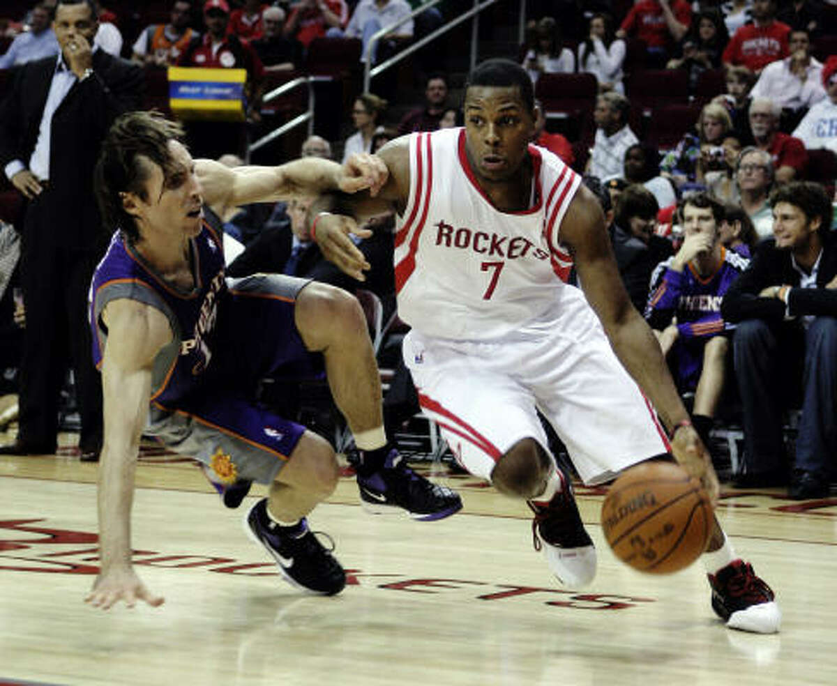 Rockets guard Kyle Lowry drives past Suns guard Steve Nash as he loses his balance in the third.