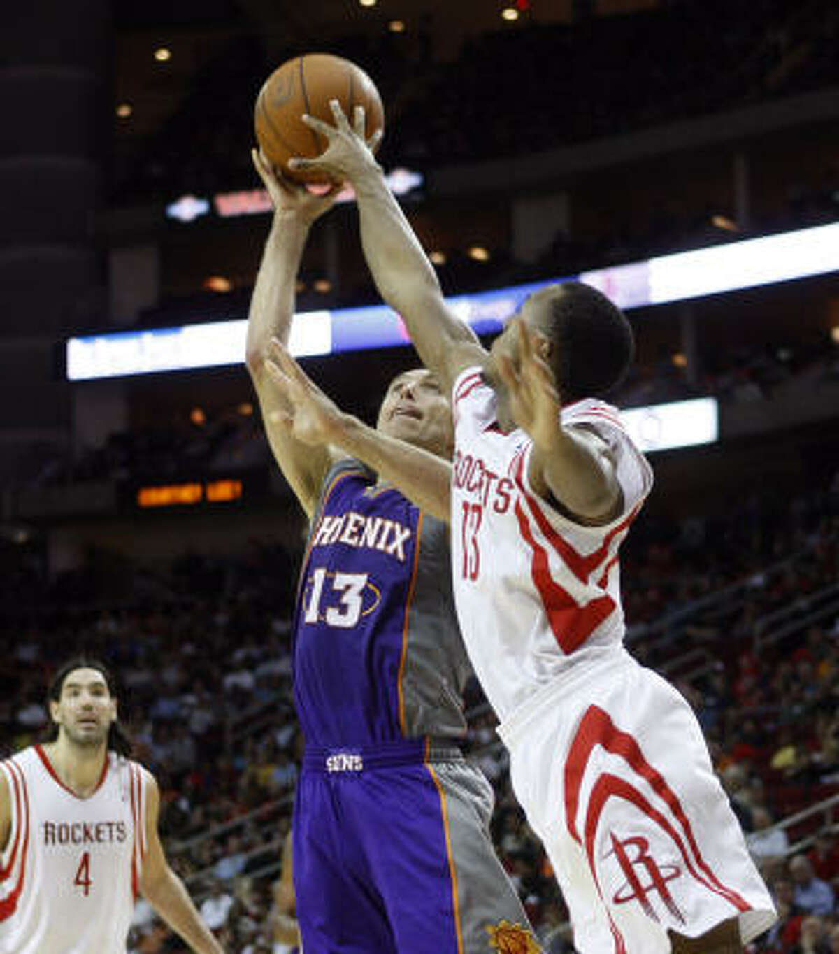 Suns' Steve Nash has his shot blocked by Rockets guard Ishmael Smith in the first quarter.