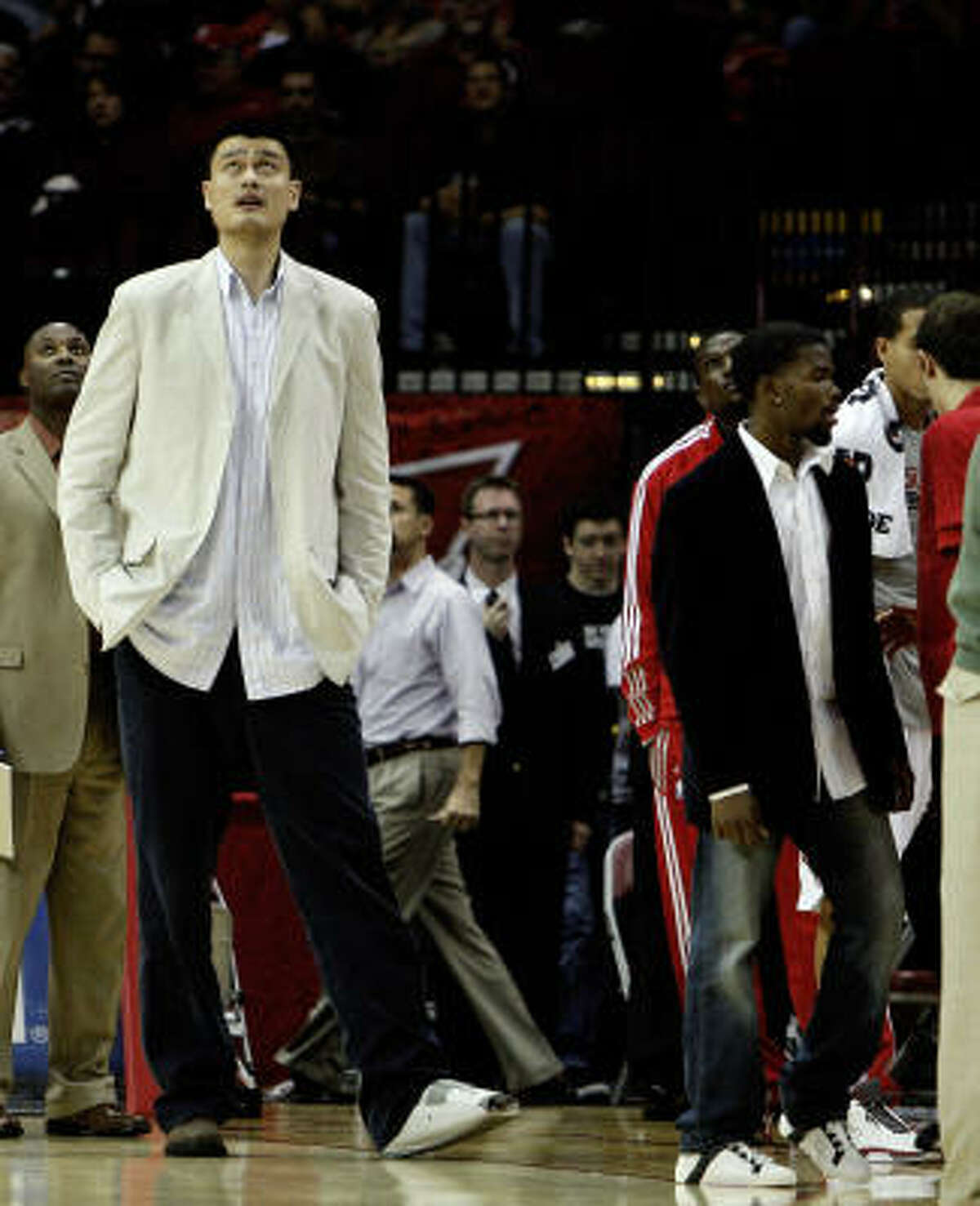 Rockets injured center Yao Ming looks on from the sideline. Yao is out with a bone bruise in the left ankle.