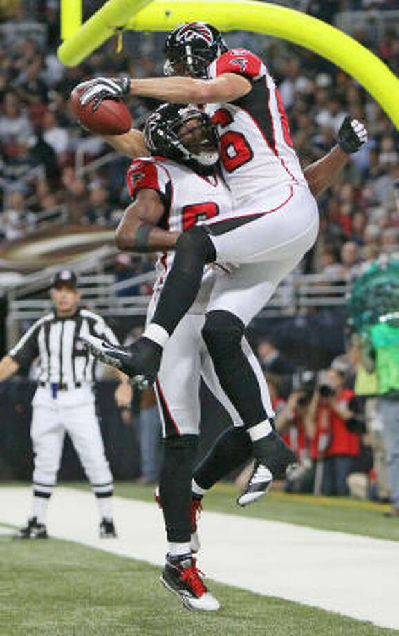 Falcons 34, Rams 17Falcons wide receiver Roddy White, left, congratulates teammate Brian Finneran after Finneran caught a 12-yard touchdown pass. Photo: Chris Lee, MCT
