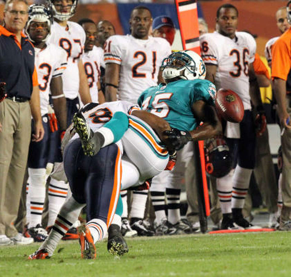 Nov. 18: Bears 16, Dolphins 0 Dolphins wide receiver Davone Bess (15) missed the pass but did not avoid a hit from Bears safety Danieal Manning in the fourth quarter of Thursday night's game at Sun Life Stadium in Miami.