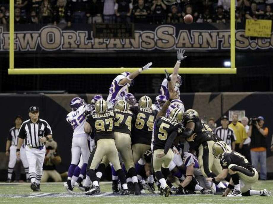 New Orleans Saints kicker Garrett Hartley (5) kicks the game-winning field goal during overtime to send the Saints to the Super Bowl. With the new overtime rule both teams will be given a possession. Photo: Mark Humphrey, AP