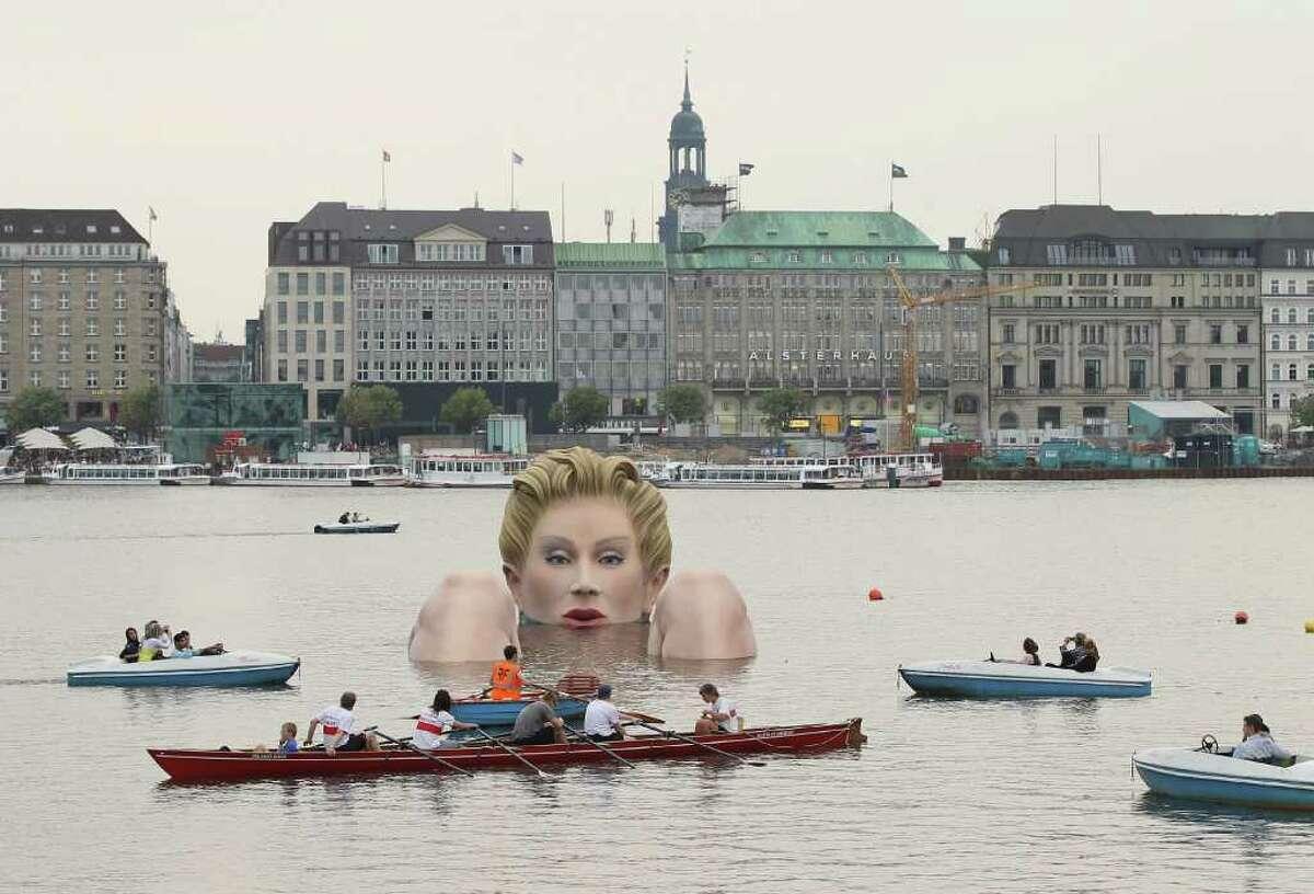 "People in boats approach ""Die Badende"" on August 3, 2011 in Hamburg, Germany."