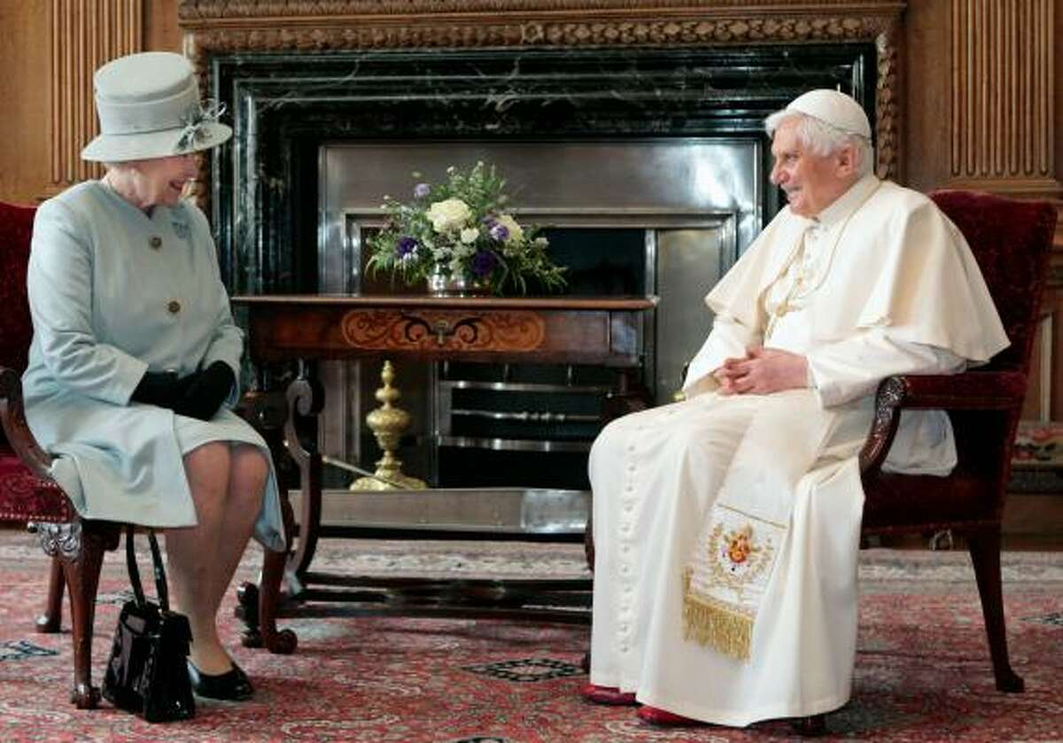 Britain's Queen Elizabeth meets with Pope Benedict XVI at the Palace of Holyroodhouse in Edinburgh, Scotland.
