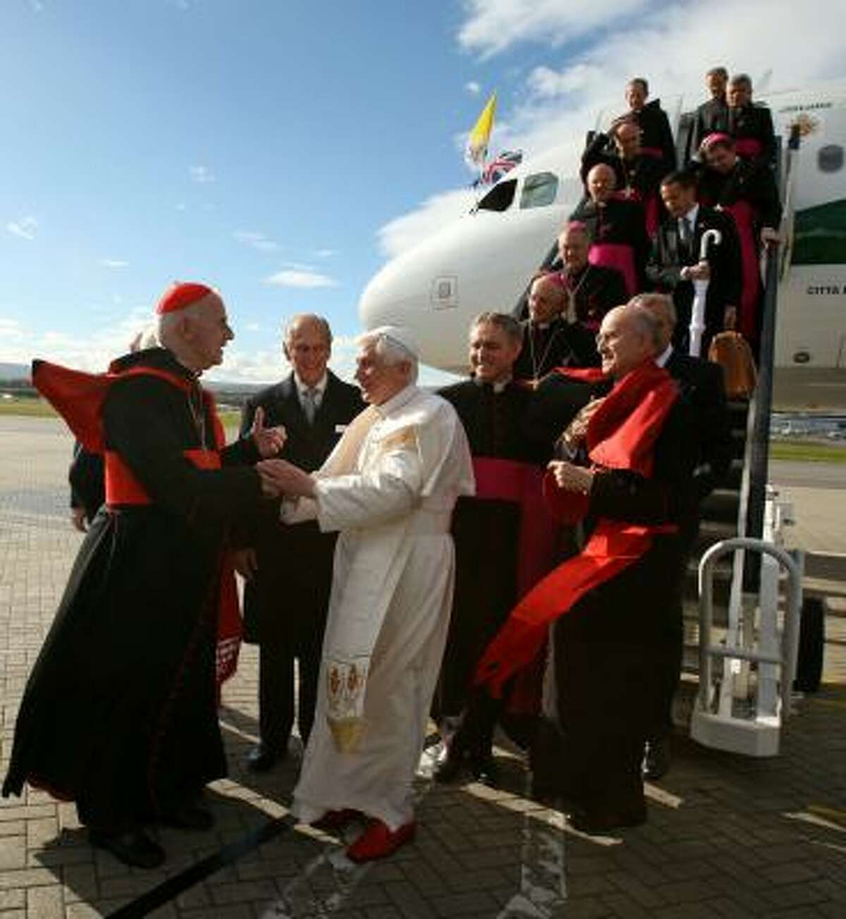 Cardinal Keith O'Brien greets Pope Benedict XVI at Edinburgh Airport in Scotland. During the four-day visit Pope Benedict will celebrate mass, conduct a prayer vigil and beatify Cardinal Newman at an open air mass in Cofton Park. The Pope is also set to meet with the Queen, as well as political and religious representatives.