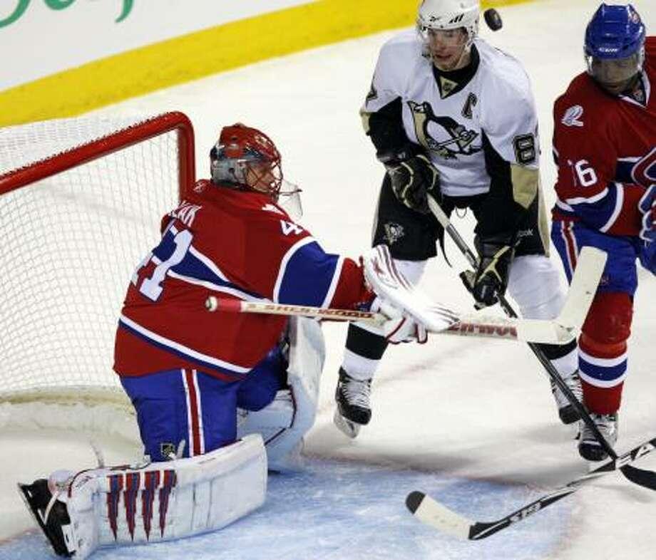 Penguins' Sidney Crosby battles for a loose puck in front of Canadiens goaltender Jaroslav Halak. Photo: Ryan Remiorz, AP