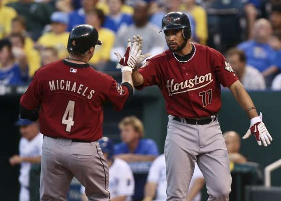 Jason Michaels (4) and Pedro Feliz celebrate after scoring on Michael Bourn's double in the fourth inning of Tuesday's 15-7 loss to the Royals. Photo: ED ZURGA, AP