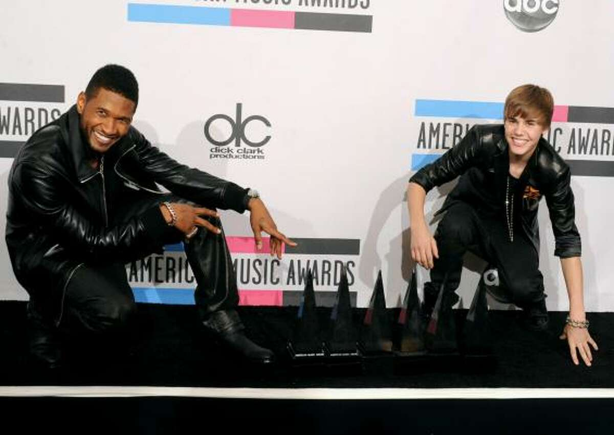 Usher (Favorite Soul/R&B Album and Favorite Soul/R&B Male Artist), left, and his protege, Justin Bieber (Breakthrough Artist Award, Pop/Rock Favorite Male Artist and Artist Of The Year).