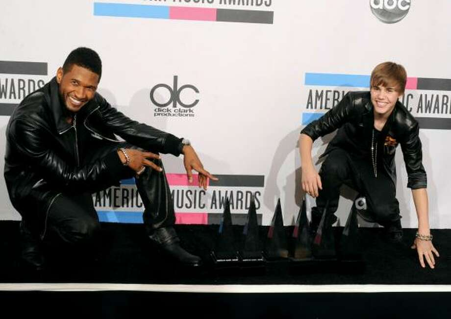 Usher (Favorite Soul/R&B Album and Favorite Soul/R&B Male Artist), left, and his protege, Justin Bieber (Breakthrough Artist Award, Pop/Rock Favorite Male Artist and Artist Of The Year). Photo: Jason Merritt, Getty Images