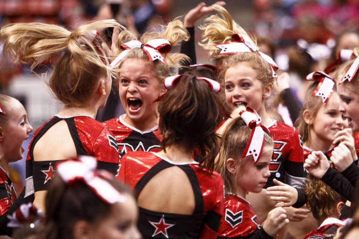 Members of the Woodlands Elite dance team react after winning an award during the Cheer America Platinum Championship dance competition at Reliant Arena in Houston.