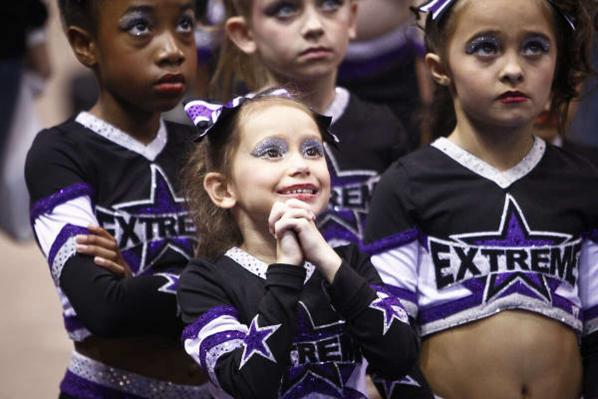 Cheerleaders watch during the Cheer America Platinum Championship dance competition at Reliant Arena. Thirteen years ago Cheer America began its journey in the competitive cheer and dance arena for the sole purpose of providing athletes, coaches and parents with quality competitions.