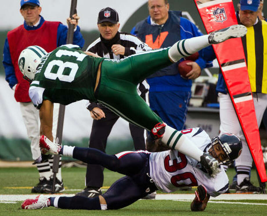 Jets tight end Dustin Keller (81) is upended by Texans cornerback Jason Allen during the second half. Photo: Smiley N. Pool, Chronicle