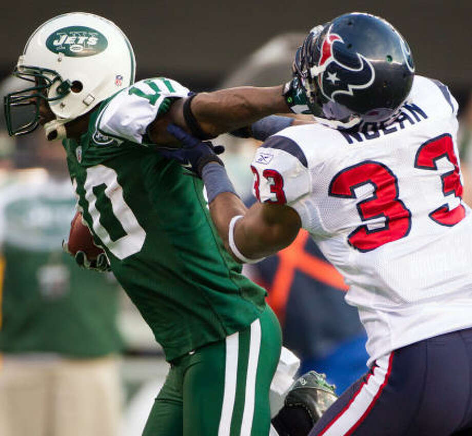 Jets wide receiver Santonio Holmes (10) gets past Texans safety Troy Nolan on his way to a 41-yard touchdown reception during the third quarter. Photo: Smiley N. Pool, Chronicle