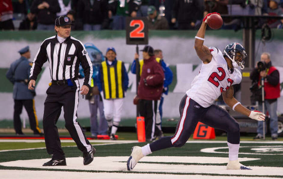 Texans running back Arian Foster spikes the ball after scoring a touchdown late during the fourth qu