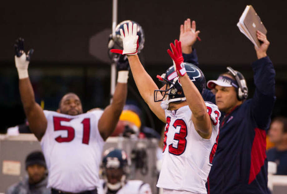 Texans wide receiver Kevin Walter (83) and linebacker Darryl Sharpton (51) celebrate after a review upheld a touchdown by running back Arian Foster during the second half. Photo: Smiley N. Pool, Chronicle