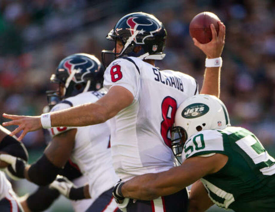 Texans quarterback Matt Schaub (8) is hit in the back by Jets defensive end Vernon Gholston (50) while attempting a pass during the first quarter. Photo: Smiley N. Pool, Chronicle