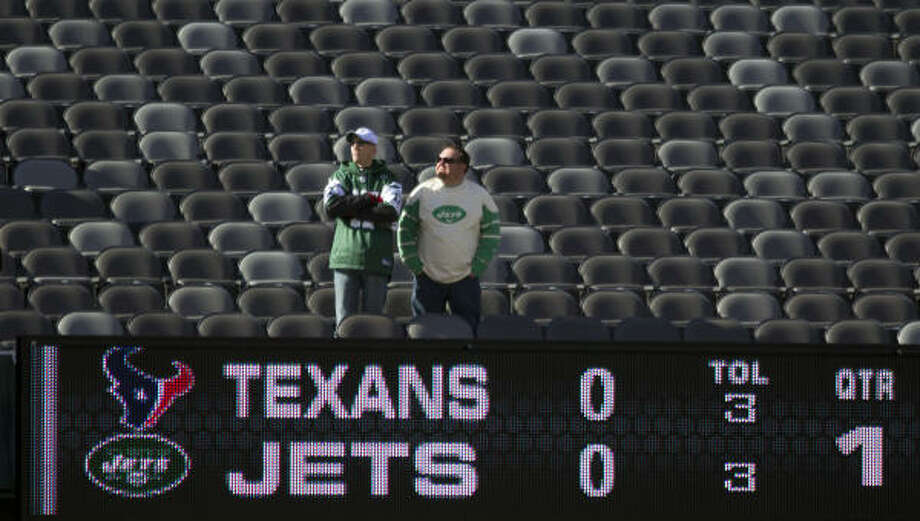 Fans watch the Texans and Jets warm up before Sunday's game. Photo: Smiley N. Pool, Chronicle