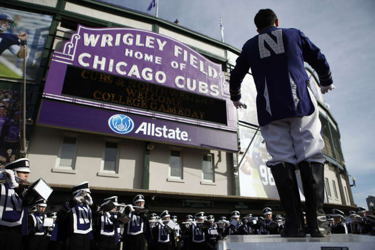 Nov. 20: Illinois 48, Northwestern 27 Northwestern's marching band performs outside Wrigley Field prior to the game.